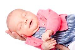 在手中放置逗人喜爱的婴孩 免版税库存图片
