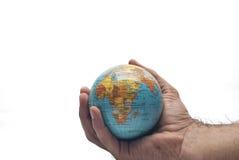 在手中查出的世界 免版税图库摄影