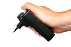 在手中被隔绝的照相机的充电器 免版税图库摄影