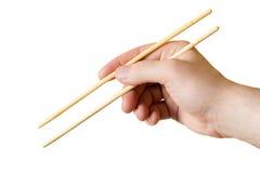 在手中被隔绝的筷子 库存照片