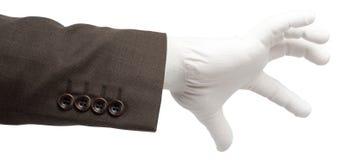 在手套的商人手 免版税库存图片