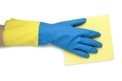 在手套黄色蓝色的手 免版税库存图片