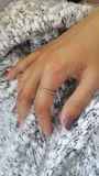 在手指的圆环 免版税图库摄影