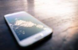 在手机的云彩 库存照片