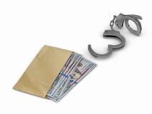 在手铐旁边驱散的美元 库存图片