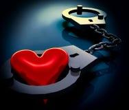 在手铐的爱心脏 免版税库存照片