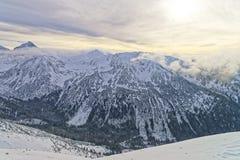 在扎科帕内Kasprowy Wierch峰顶的日落在Tatras在冬天 图库摄影