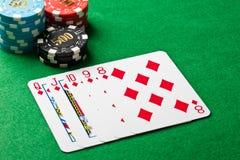 在扑克牌游戏的同花顺 库存图片