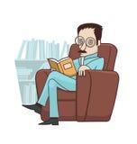 在扶手椅子的阅读书 免版税图库摄影