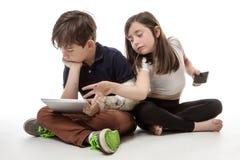 在技术大字书写的孩子 免版税库存照片