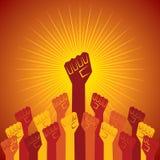 在抗议概念握的握紧拳头 免版税库存图片