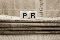 在报纸的简称PR 免版税库存图片