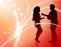 在抽象情人节光背景的性感的年轻夫妇 免版税库存照片