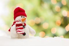 在抽象背景的小的雪人 免版税库存图片