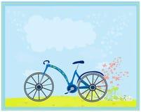 在抽象背景的蓝色自行车 免版税图库摄影