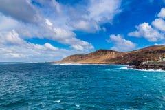在拉斯帕尔马斯,大加那利岛,西班牙附近的海滨 免版税库存照片