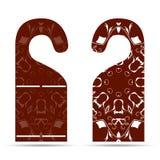 在拉门吊挂装置装饰品的两个标记与红色和白色 库存照片