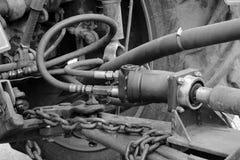 在拖拉机的外部的水管 免版税库存图片