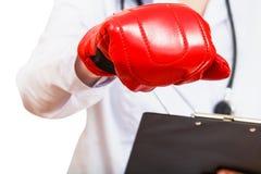 在拳击手套的护士手 库存照片