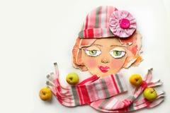 在拼贴画技术创造的装饰画象使用纸、纺织品项目和果子 季节性卡片 库存照片