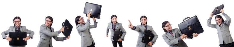 在拿着公文包的灰色衣服的年轻商人被隔绝在whi 免版税库存图片