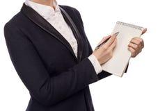 在拿着笔和笔记本的西装的手 免版税库存照片