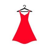 在挂衣架的红色礼服 免版税库存照片