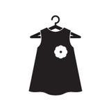 在挂衣架的黑小的礼服 库存图片