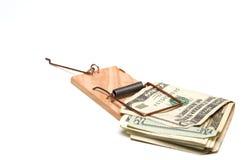 在捕鼠器的美元票据 库存照片
