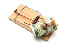 在捕鼠器的钞票 库存照片