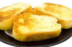 在接近的大蒜上添面包  免版税库存图片