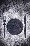 在搽粉的糖的刀子、叉子和板材版本记录 图库摄影