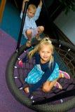 在摇摆的儿童乘驾 免版税图库摄影