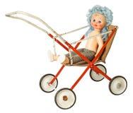 在摇篮车的玩偶 库存图片