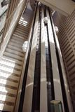 在摩天大楼里面的电梯 库存照片