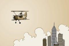 在摩天大楼附近的双翼飞机 向量例证