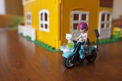 在摩托车的一个女孩玩偶 免版税库存照片