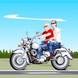 在摩托车的夫妇 免版税库存照片