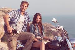 在摩托车的时髦的夫妇 图库摄影