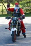在摩托车的父亲圣诞节 库存照片