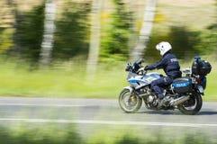 在摩托车的警察 图库摄影