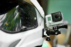 在摩托车盔甲的行动照相机 库存图片
