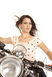 在摩托车头发吹的神色的妇女关闭 免版税图库摄影