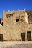 在摩洛哥contruction村庄砖墙的小山非洲 免版税库存图片
