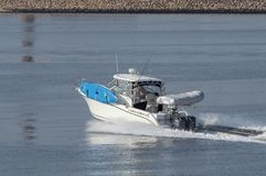 在撇取在新贝德福德的态度上的快速汽艇变化外面 图库摄影