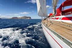 在撒丁岛海岸,意大利的帆船 图库摄影