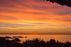 在撒丁岛海滩的晚上光 库存图片