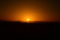 在撒哈拉大沙漠的五颜六色的日落 库存照片