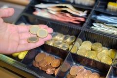 在收款机的硬币 库存图片