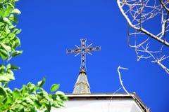 在教会的十字架 库存照片